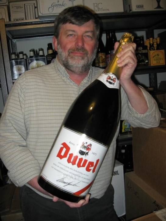 Beveridge Place Pub Owner, Gary Sink, with the bottle of Duvel that will be shared during the 11th anniversary celebration.