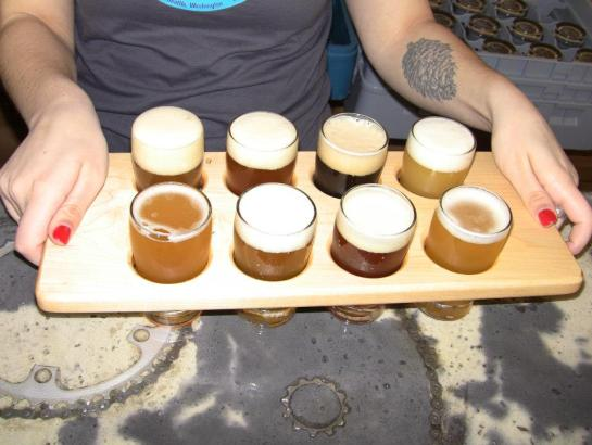 A Sampler Tray Of Peddler Brewing's 8 Opening Day Beers