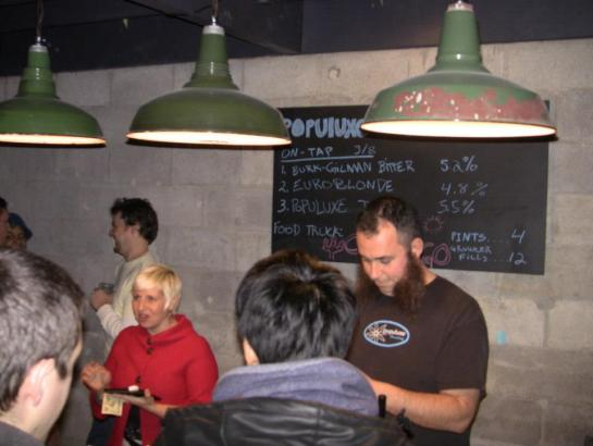 Populuxe Brewer/Owner Peter Charbonnier Busy Pouring Beer