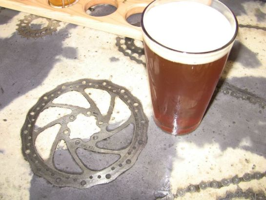 Gears And Chains Embedded In The Bar Top At Peddler Brewing