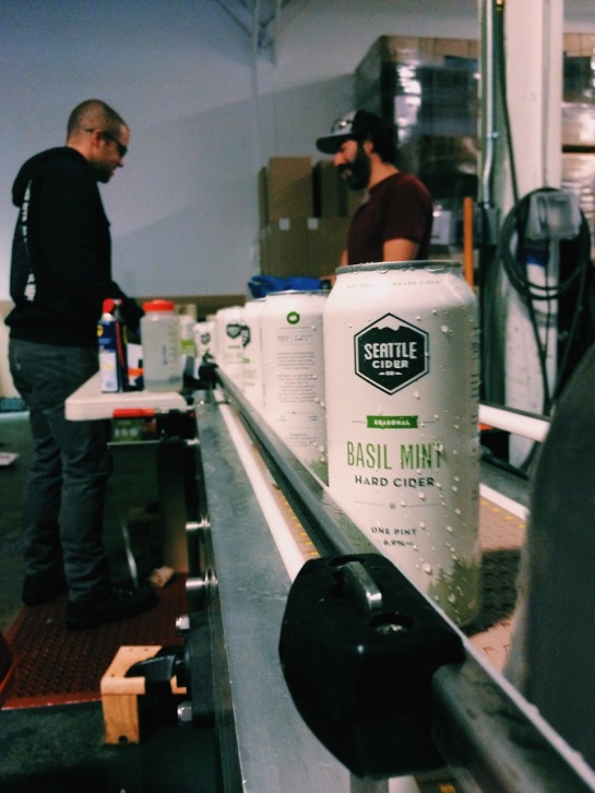 Seattle Cider Company Basil Mint Cider Coming Down The Canning Line